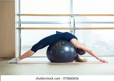 Woman on a fitness ball in  gym