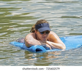 Woman on a Float in the Water