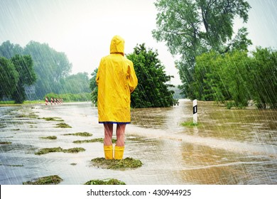Woman on a flooded street