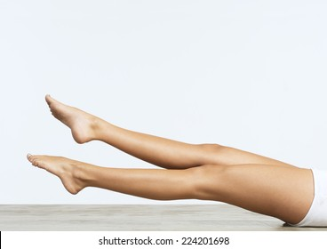 Woman on floor doing leg exercises