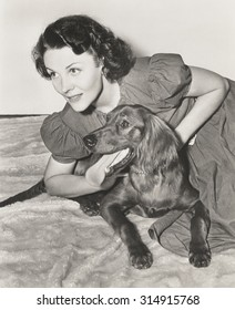 Woman on the floor with her Irish setter