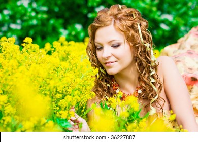 a woman on the grass with flowers