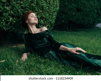 woman on the grass in a green dress