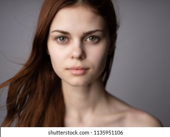 woman on gray background view