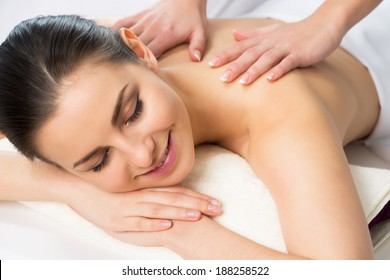 Woman on healthy massage of body in the spa salon.