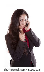 A woman is on her cell phone and pointing her finger.