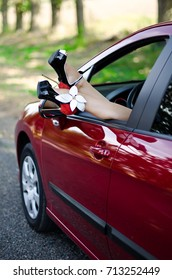 Woman on high heels in the car