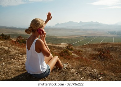 the woman on the hill talking on the phone