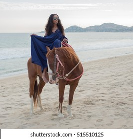 Woman on Horse at the beach