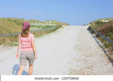 Woman on island Ameland. Wadden and North sea