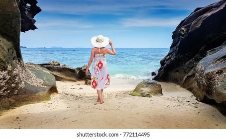 Woman on the Krabi island looking at the ocean