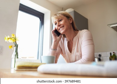 Woman On Mobile Phone In Modern Apartment