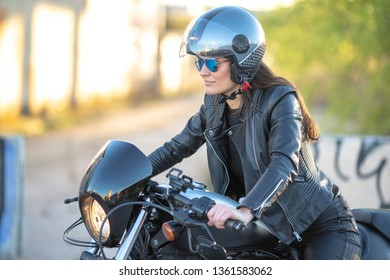 woman on motorcycle with helmet and sun  glasses