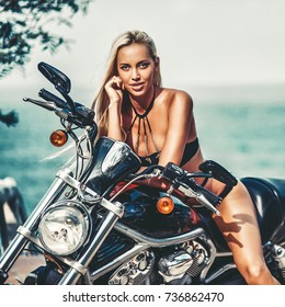 Woman on a motorcycle - outdoor fashion portrait