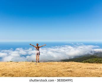 Woman on the mountain peak