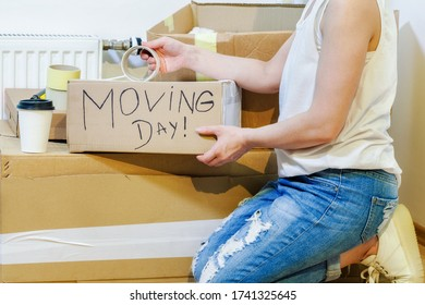 Woman on moving day.Moving Day Concept