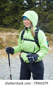 Woman on nordic walking trip in winter mountains