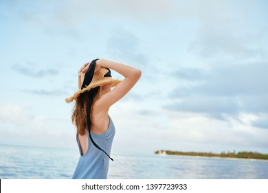 woman on the ocean in a blue swimsuit