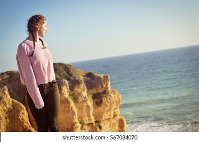 Woman on the ocean sunny blue sky background. Back side view. Holiday, adventure, nostalgic experience