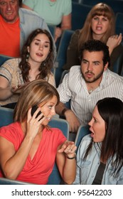 Woman on phone annoys audience in theater