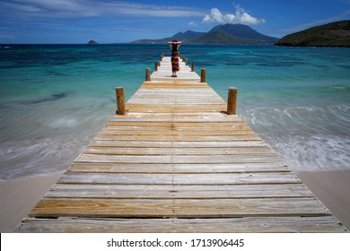 Woman on a Pier at Turtle Beach, St. Kitts.