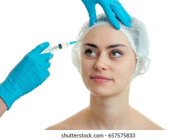 the woman on the procedure at the plastic surgeon