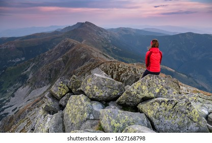 Woman on ridge of low tatras. Tourist in slovak mountains. Sunset on the mountains