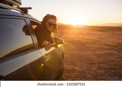 Woman on the road trip, sunset in Cabo de Gata-Nijar Natural Park, Andalusia, Spain
