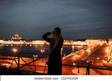 Woman on the roof. Amazing night view