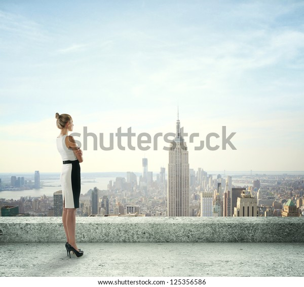 woman on roof looking at city