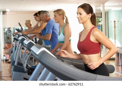 Woman On Running Machine In Gym