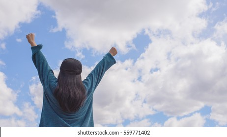 woman on sky background