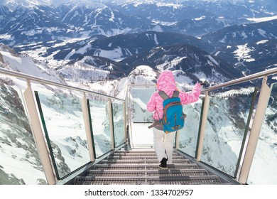 woman on skywalk on Dachstein mountain in winter