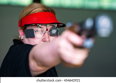 Woman on sport shooting training practicing for competition
