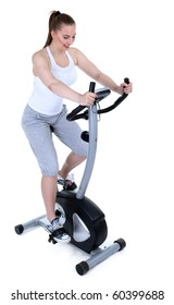 woman on stationary training bicycle - she wants to be slim