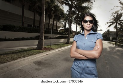 Woman on the street with her arms crossed