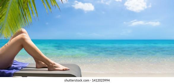 Woman on sunbed on the beach