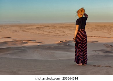 Woman on the top of dune in Namibia