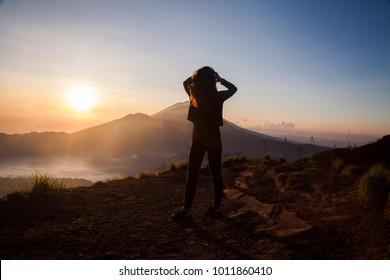 Woman on top of Mt. Batur, Bali