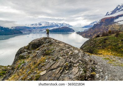 Woman on top of the rock on the Torres del Paine trek