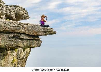 Woman on top of Table Mountain - Cape Town
