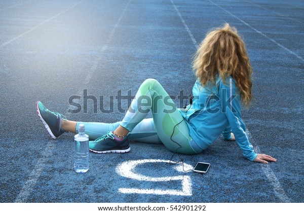 Woman on track with mobile phone