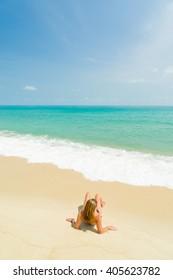 woman on the tropical  beach on a sunnt day