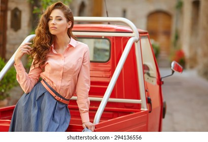Woman on typical italian street scene  in small old town