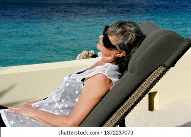 Woman on vacation relaxing at a resort beach