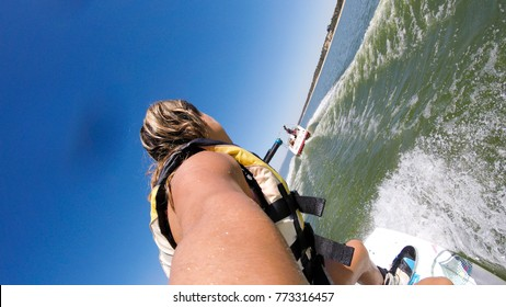 Woman on wakeboard. Sportive lifestyle