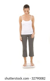 Woman on white background standing on a scale