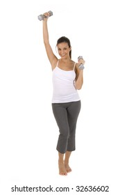 Woman on white holding silver dumbbells.