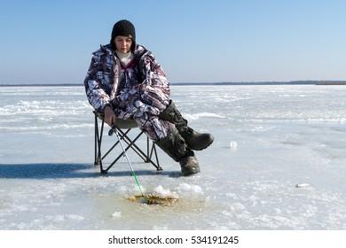 Woman on winter fishing.