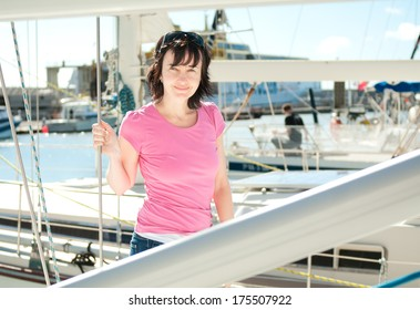 Woman on the yacht in marina in summer